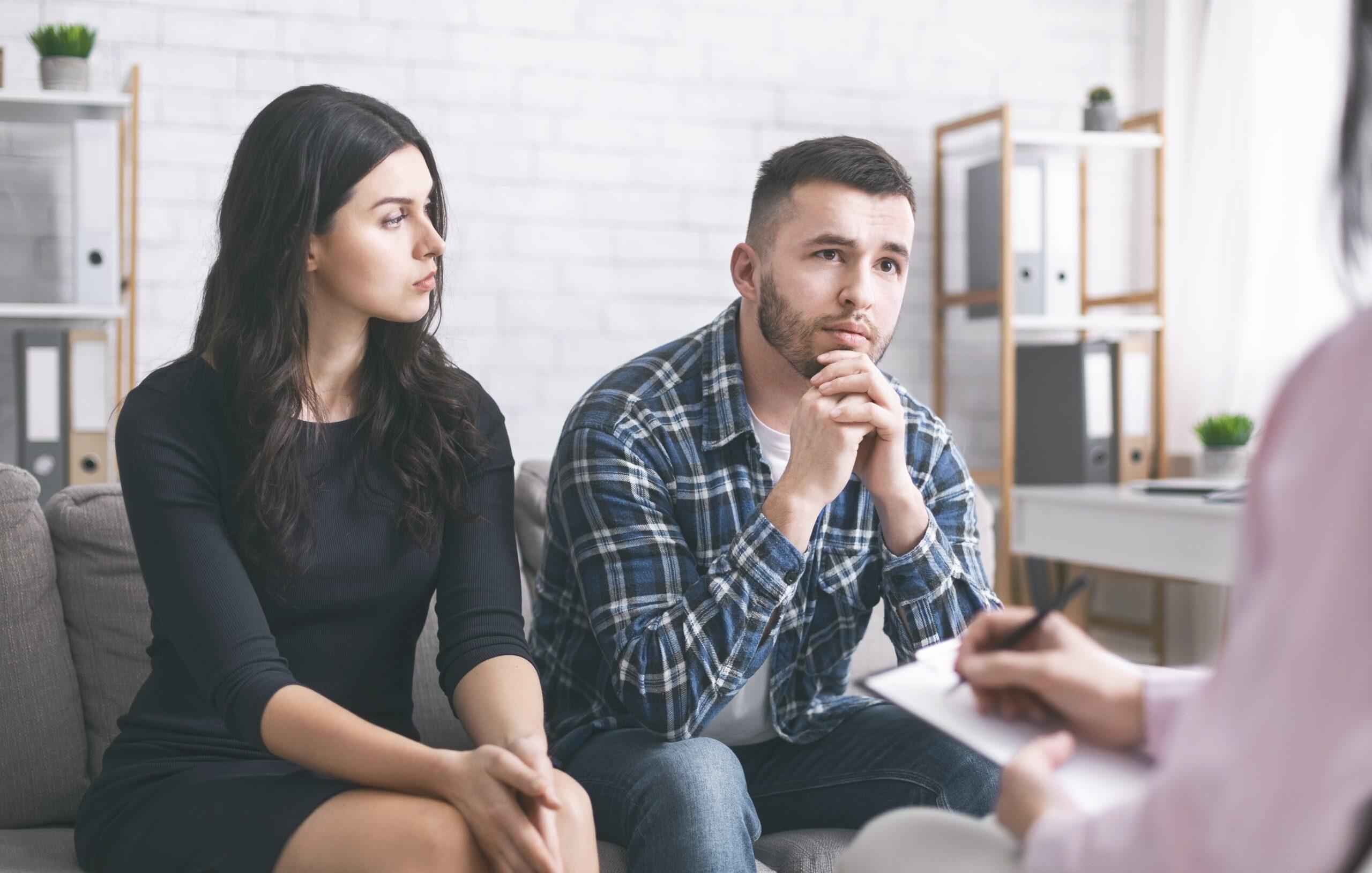 serious-man-talking-to-psychiatrist-during-marital-GAQ7LZR-min